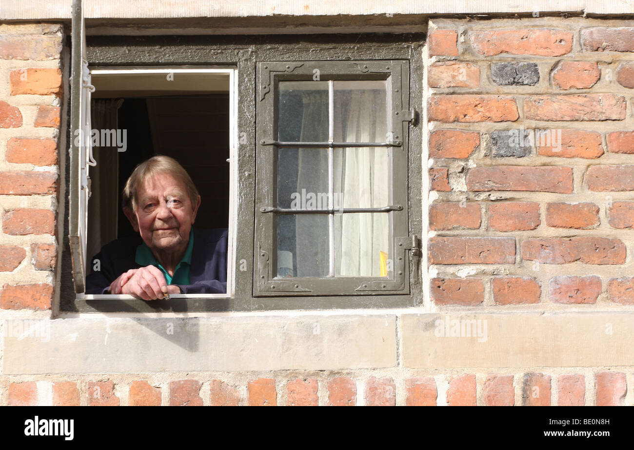 Frederiksborg Castle, man at his window - Stock Image