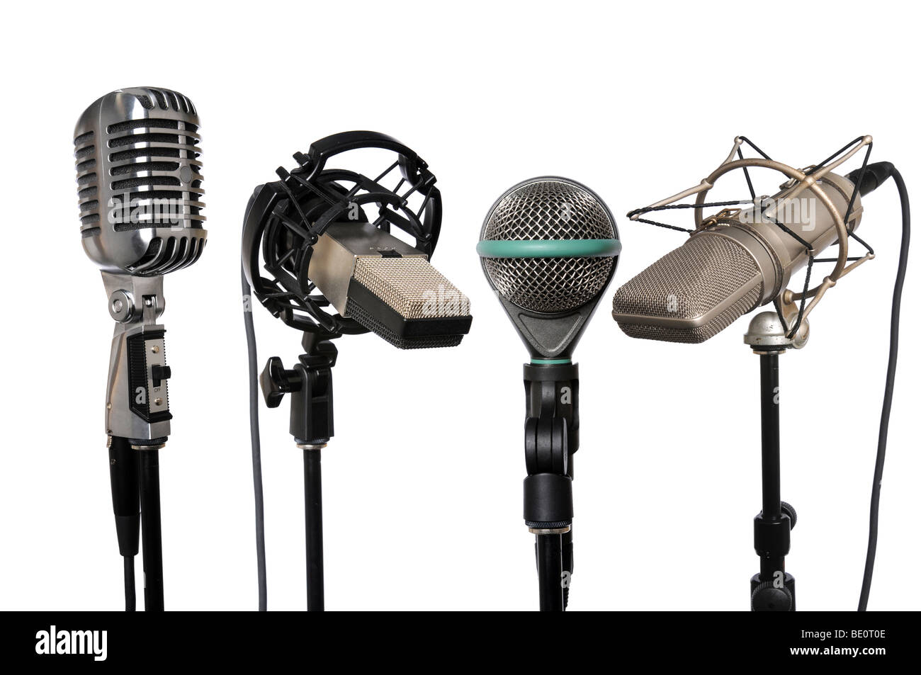 Microphones from vintage to modern aligned together - Stock Image