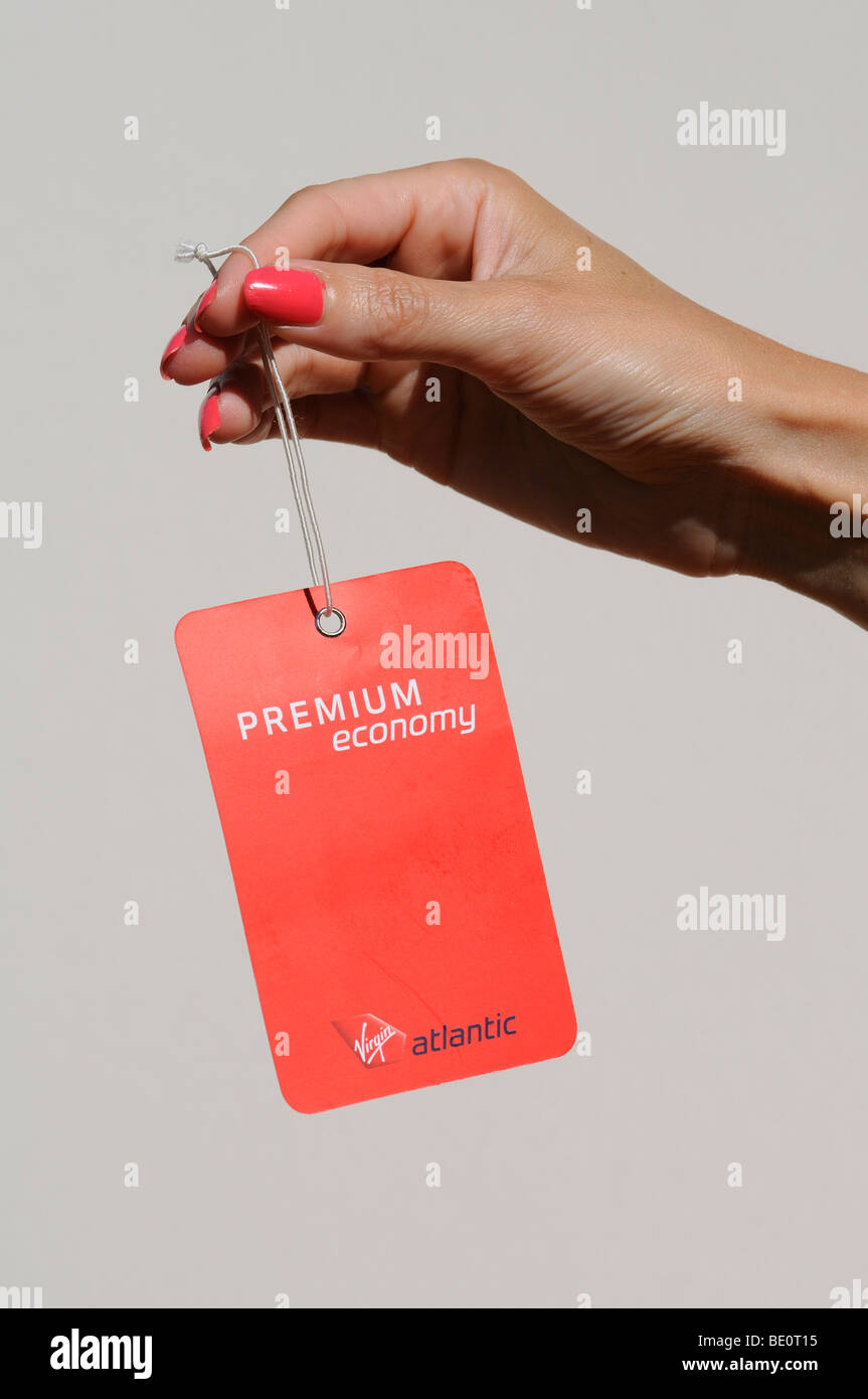 cc297bfd9d Hand holding a Virgin Atlantic premium economy baggage tag Stock ...