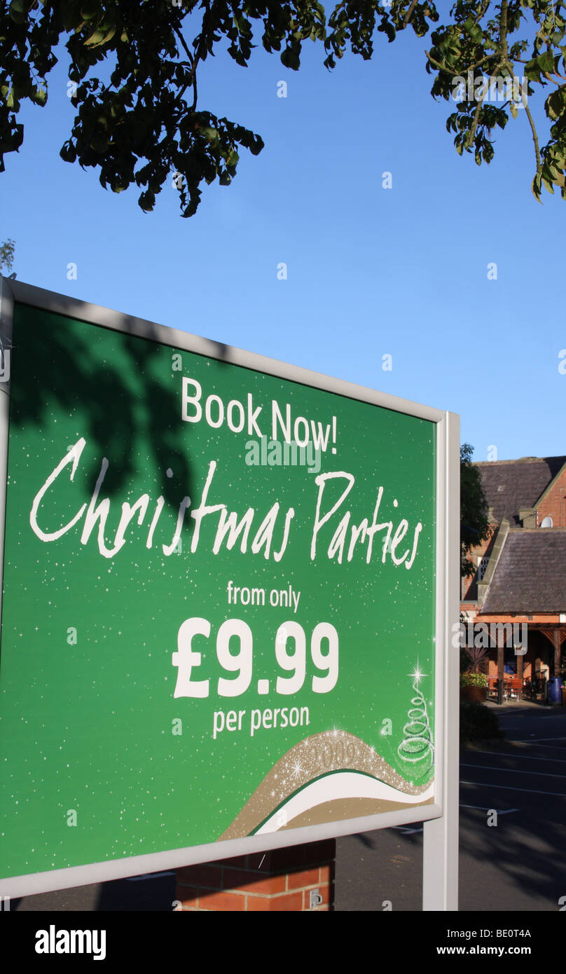A sign advertising Christmas parties at a public house in the U.K. - Stock Image