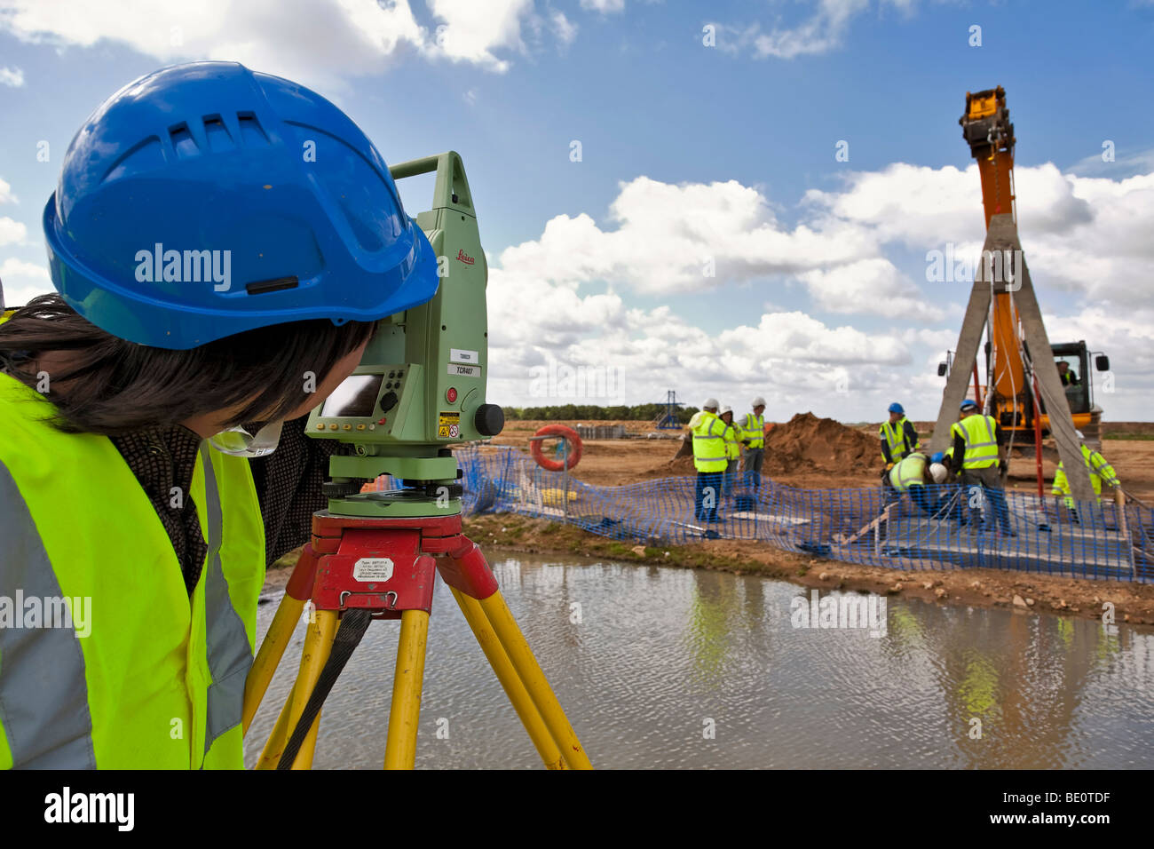 Surveyor working on bridge construction. - Stock Image