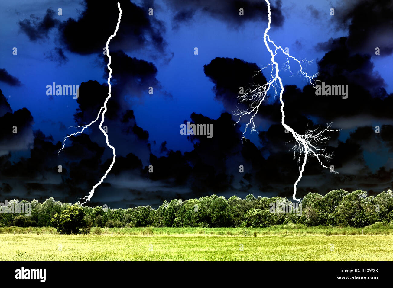 lightning bolts in field - Stock Image