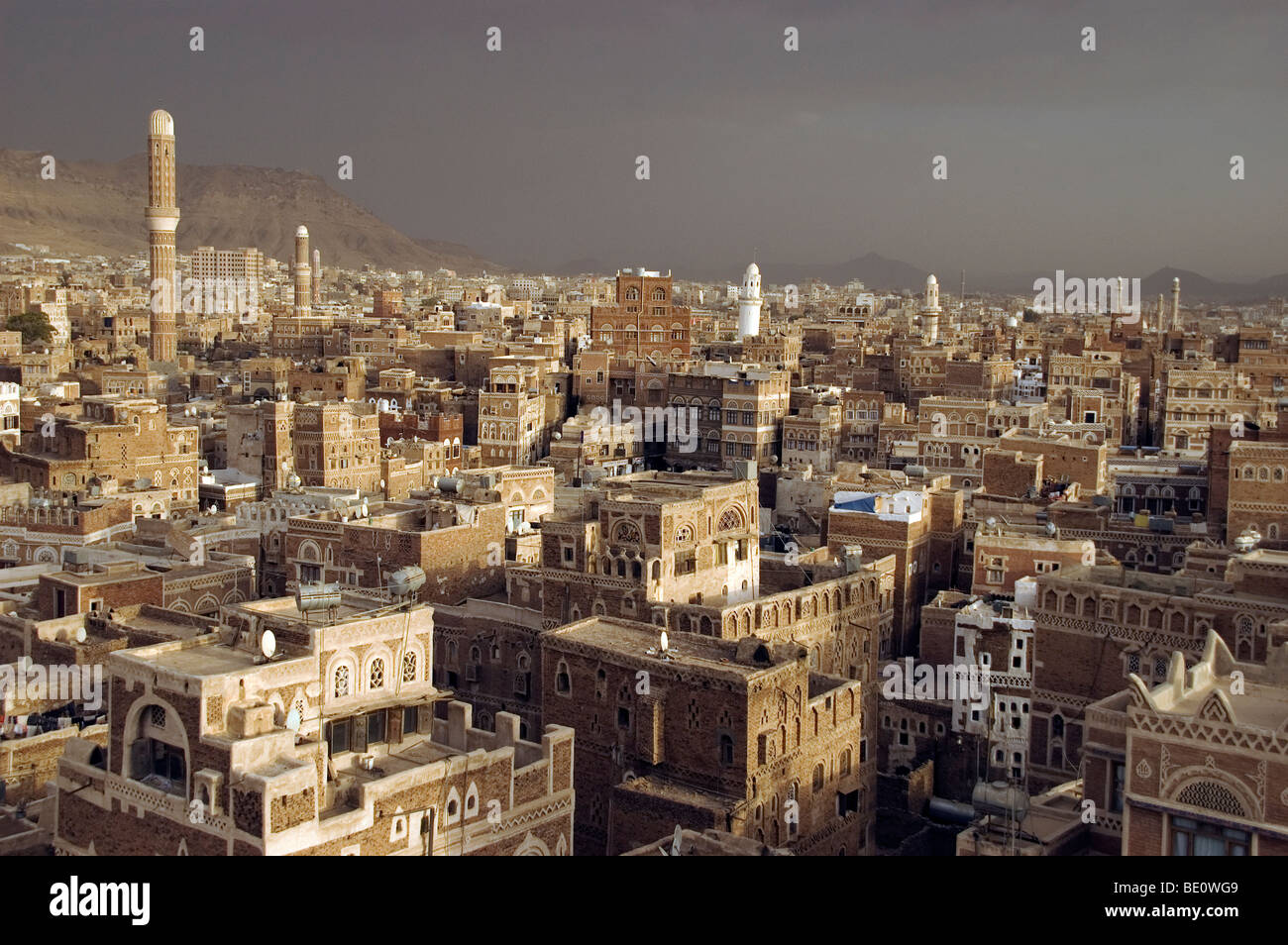 Minarets and traditional tower houses on the skyline of the old city of Sana'a, Yemen. - Stock Image