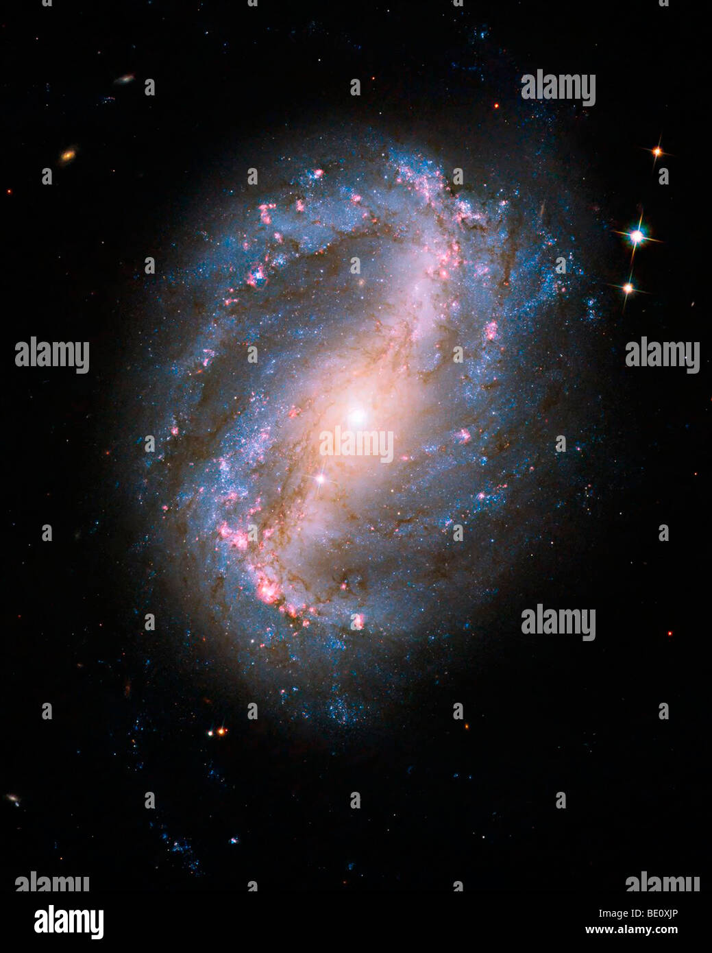 Barred Spiral Galaxy. Image from the refurbished Hubble Telescope - Stock Image