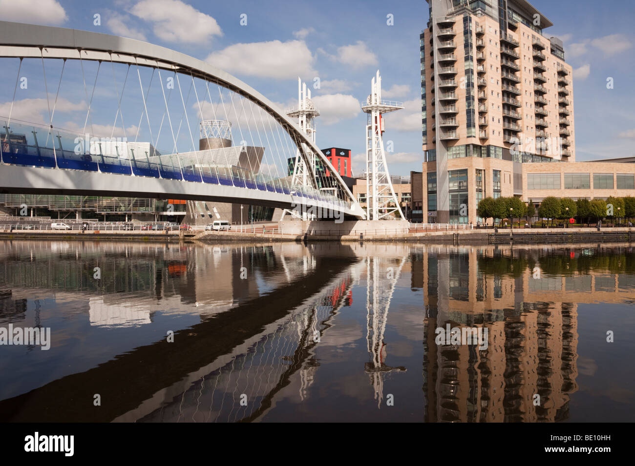 Salford Quays, Greater Manchester, England, UK. Lowry Millennium footbridge and Lowry Outlet Mall across Manchester - Stock Image