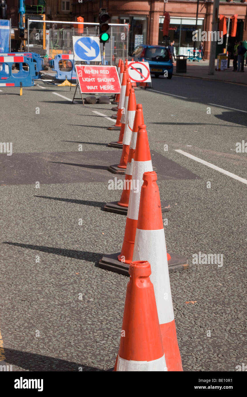 Traffic cones on a city road by roadworks. England UK Britain Europe - Stock Image