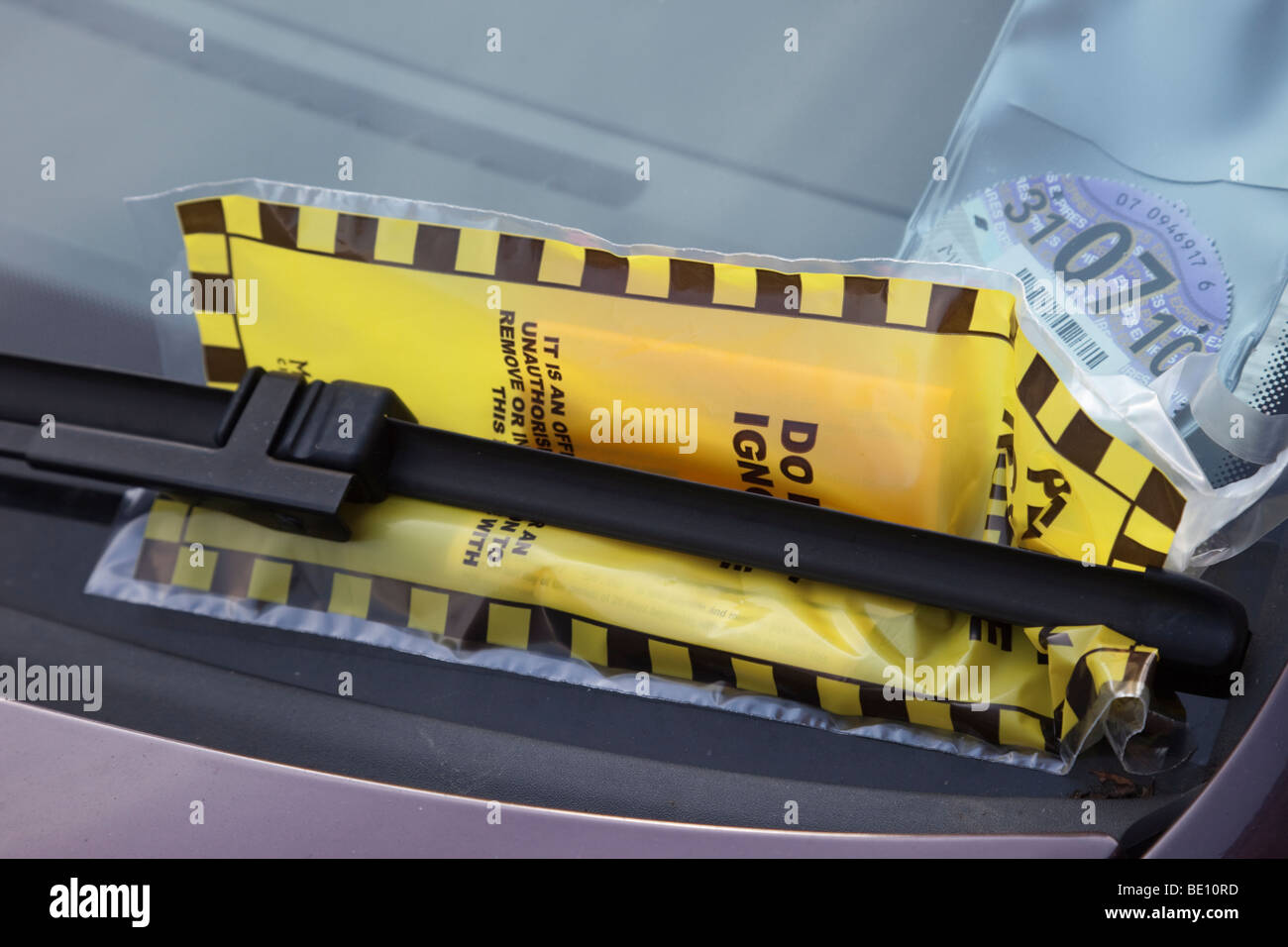 Fixed penalty parking fine ticket on a car windscreen. UK Britain Europe - Stock Image