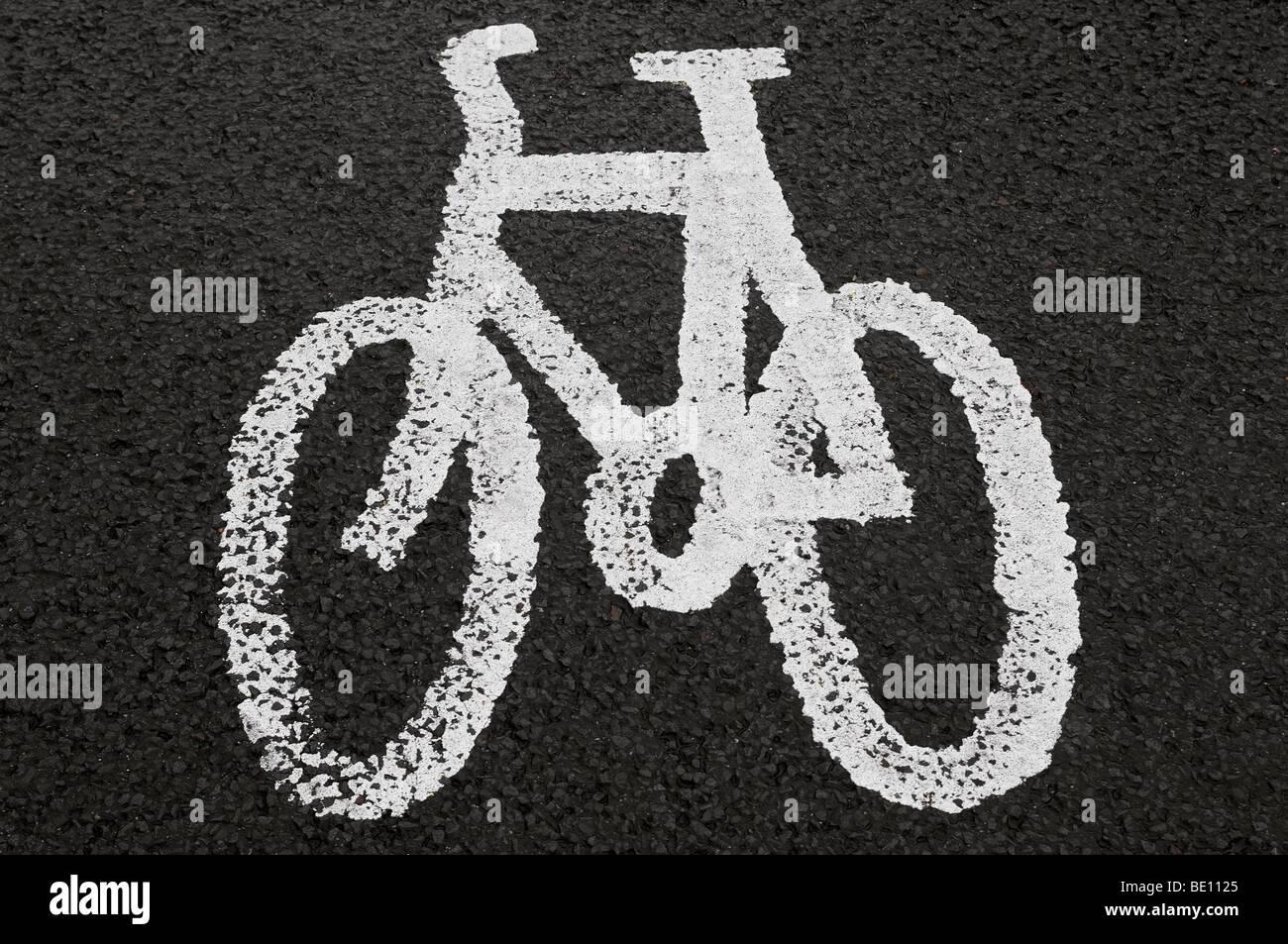 Cycle Lane Symbol Painted on Tarmac - Stock Image
