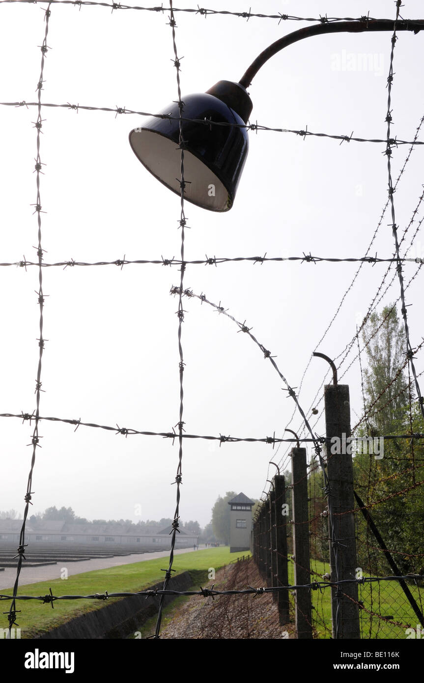 Barbed wire fence, lamp in former Dachau concentration camp, Germany ...