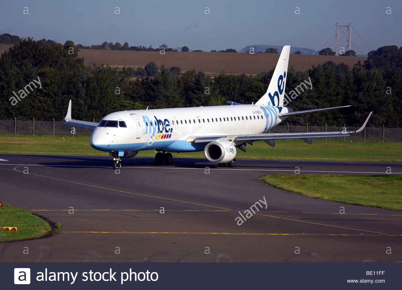 Flybe Embraer aeroplane taxiing at airport - Stock Image