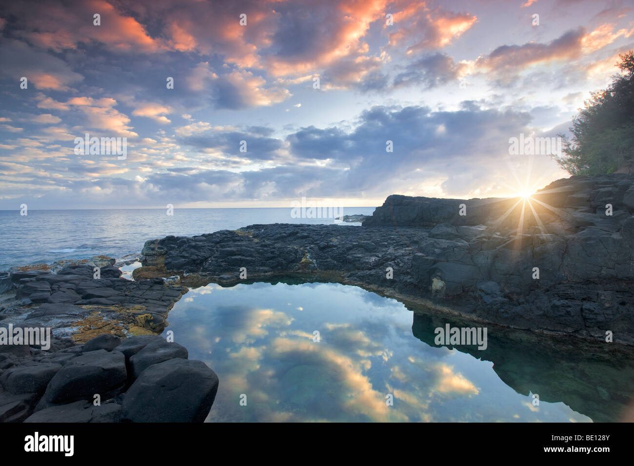 Queen's Bath with sunrise. Kauai, Hawaii. - Stock Image