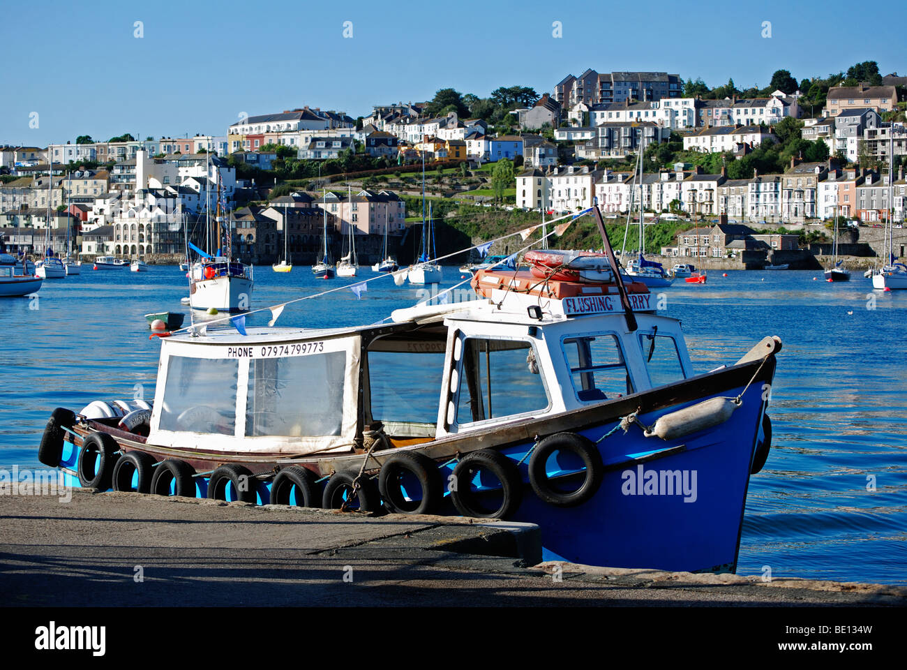 the ' flushing to falmouth ' ferry waits at the quay in flushing,cornwall,uk - Stock Image