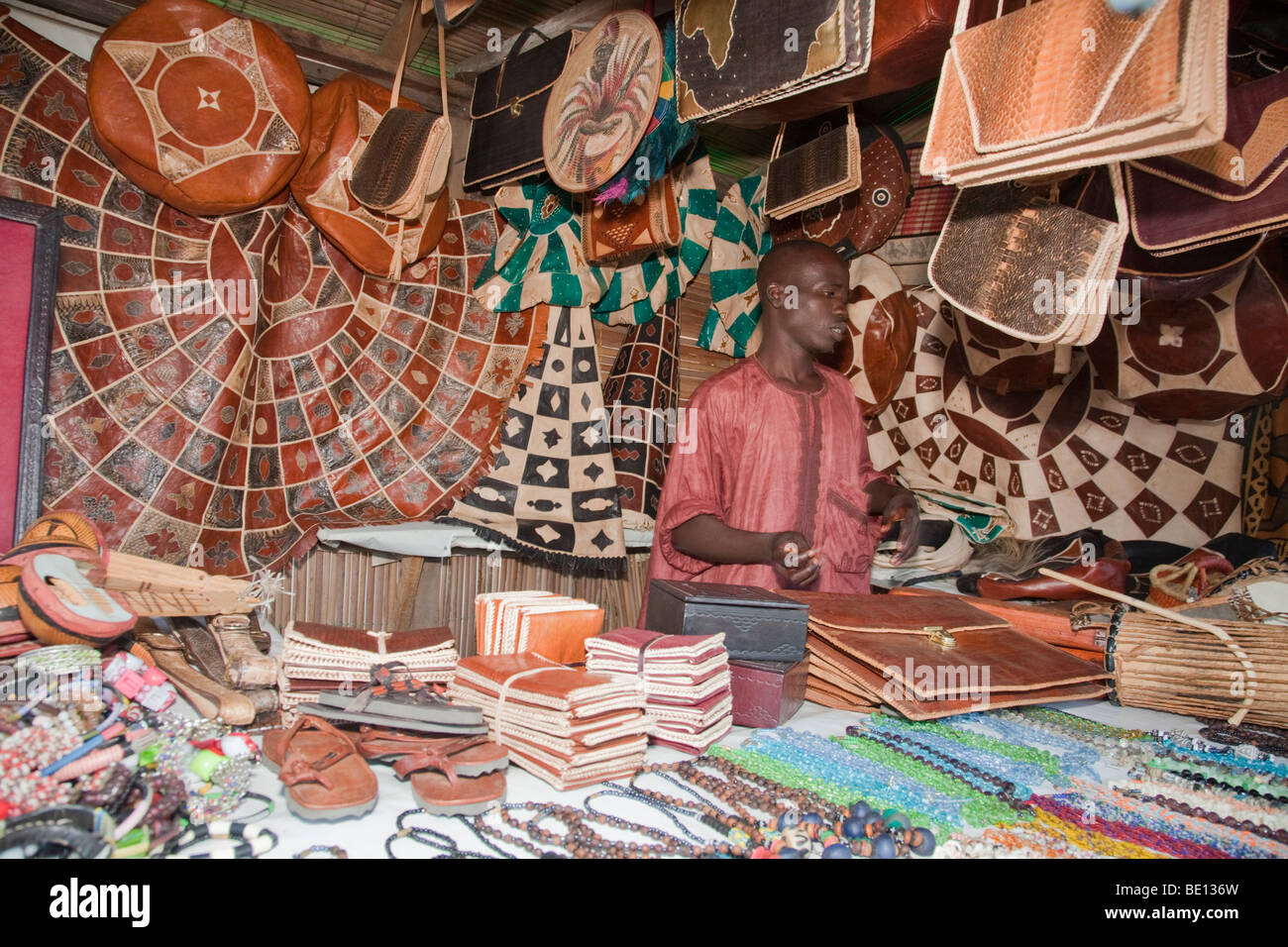 A man sells leather handicrafts inNigeria's capital city of Abuja. - Stock Image