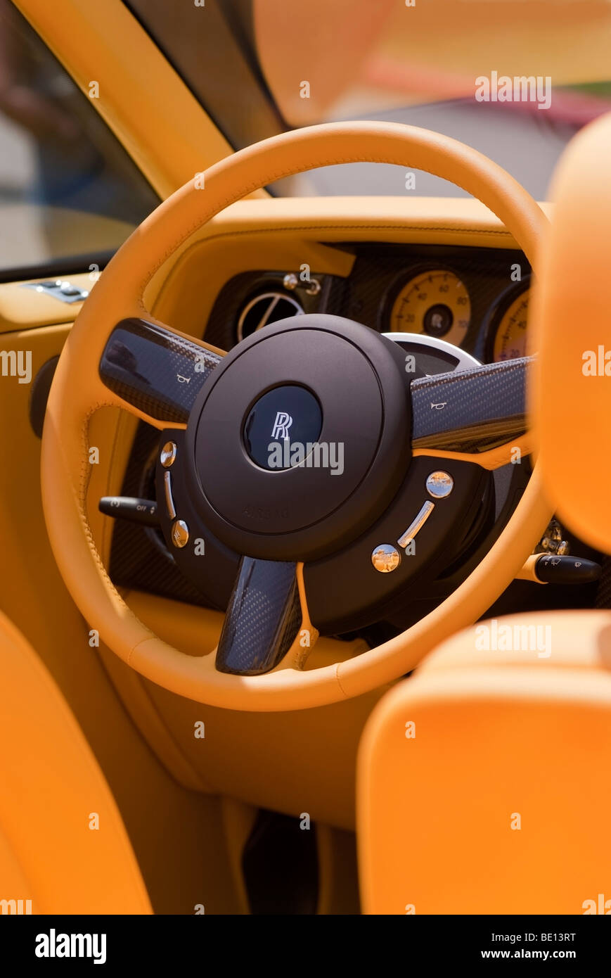 custom yellow leather interior and carbon fiber steering wheel of a