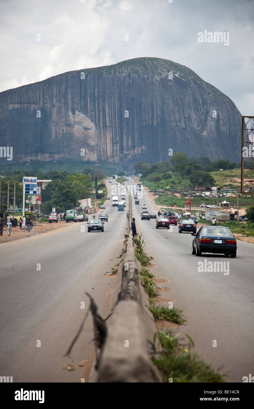 Zuma Rock is an opposing monolith in Nigeria's Niger State, towering over the road to the capital city of Abuja. - Stock Image