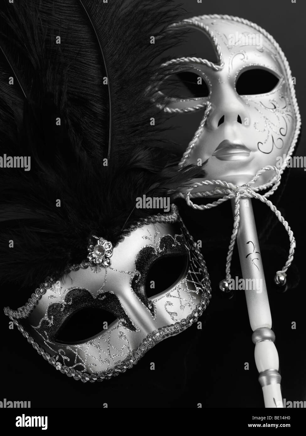 Two silvery Venetian masks - Stock Image