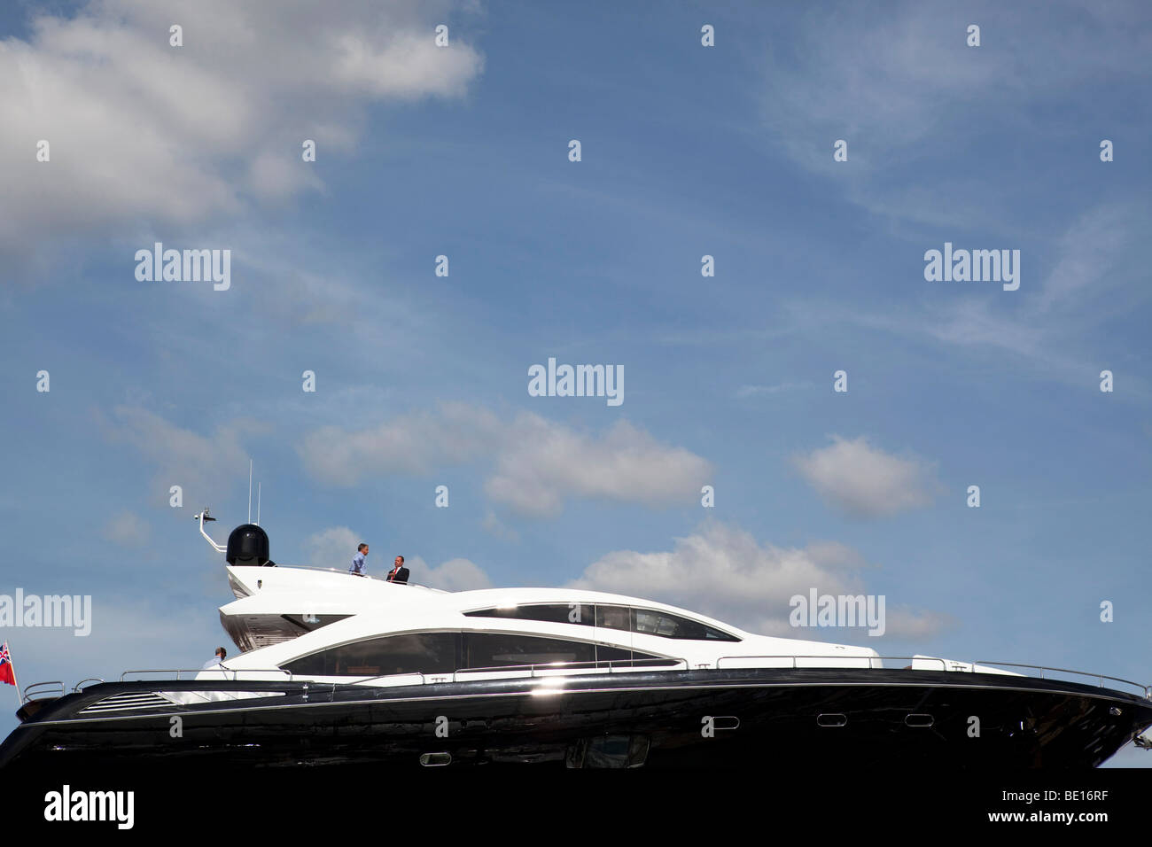 visitor to Southampton boat show on large Sunseeker motor yacht - Stock Image