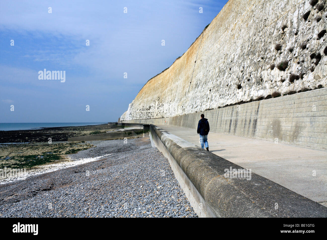 The concrete under cliff walk beneath the chalk cliffs at Peacehaven, East Sussex, England, UK - Stock Image