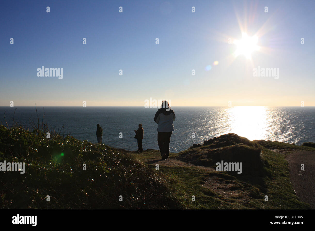 Walkers at Penlee Point near Rame Head southeast Cornwall, England, UK. - Stock Image