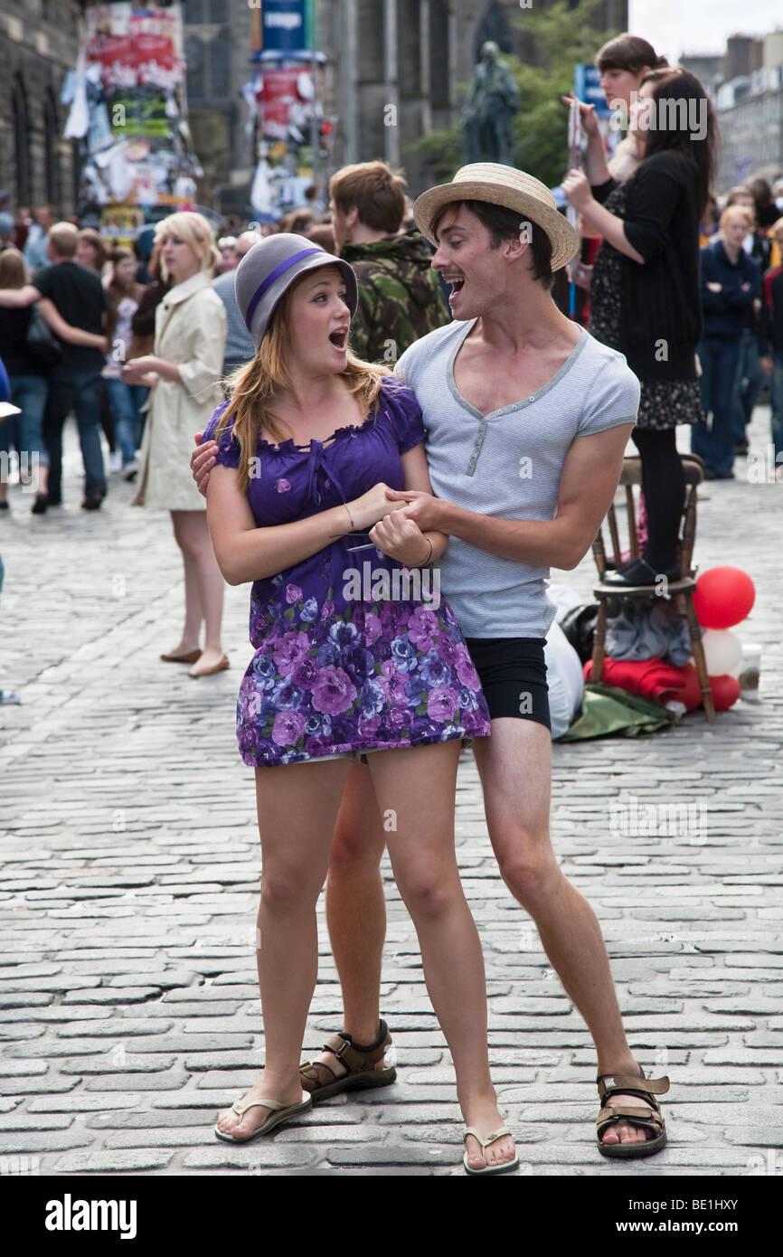 Edinburgh Festival Fringe actors promoting their performance of The Boyfriend on the Royal Mile - Stock Image