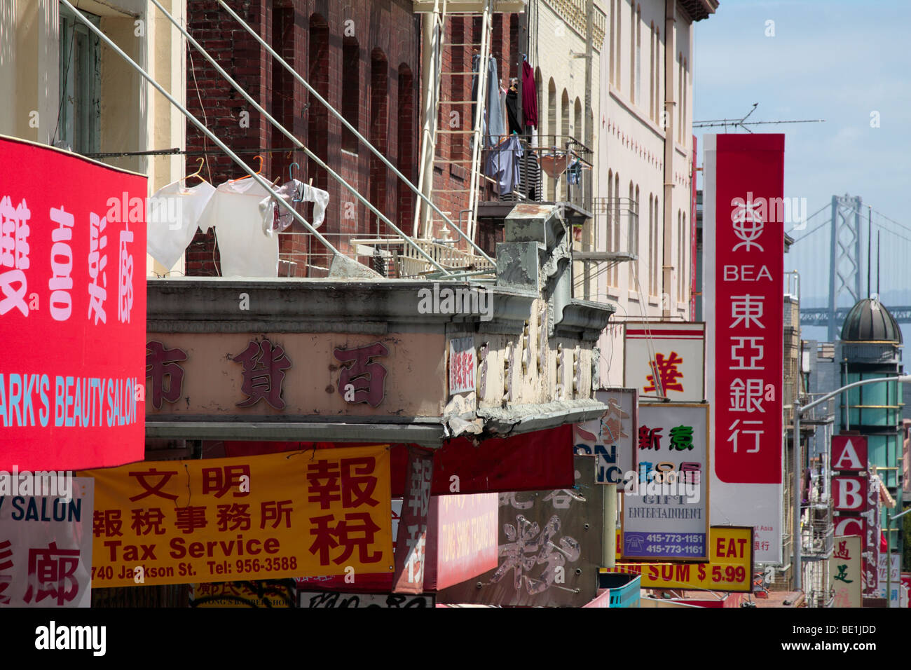 A jumble of signs in Chinatown San Francisco California USA - Stock Image