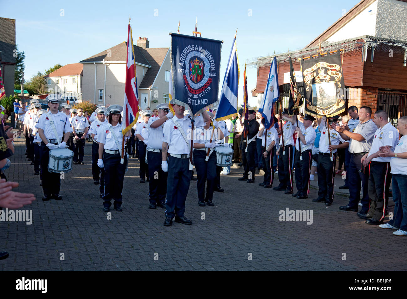 Ardrossan Winton Flute Band (Loyalist/Protestant) stand at the end of their parade in Kilwinning, Ayrshire, Scotland - Stock Image