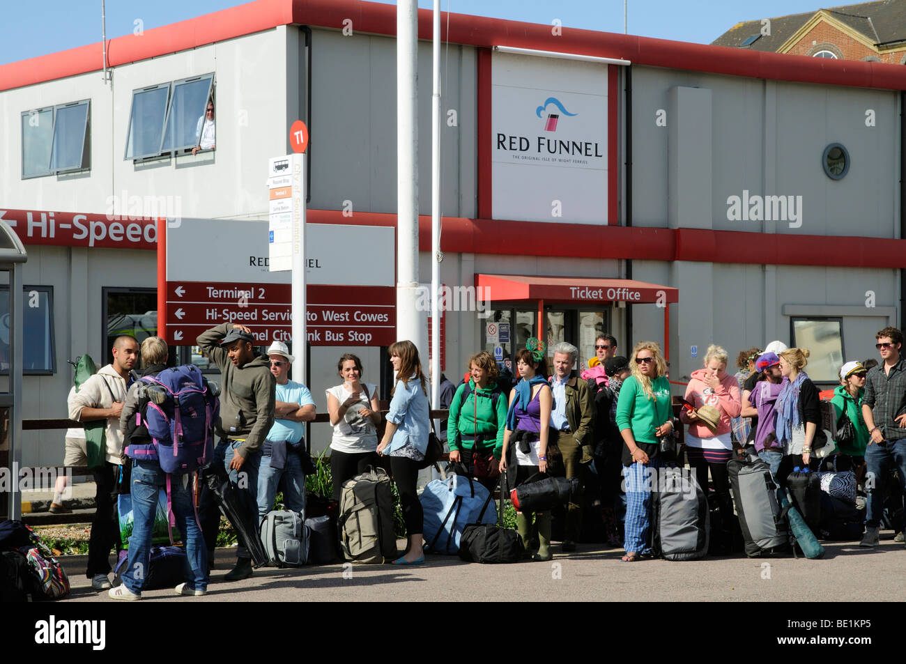 Crowded bus stop outside Red Funnel ferry terminal building Southampton England UK - Stock Image