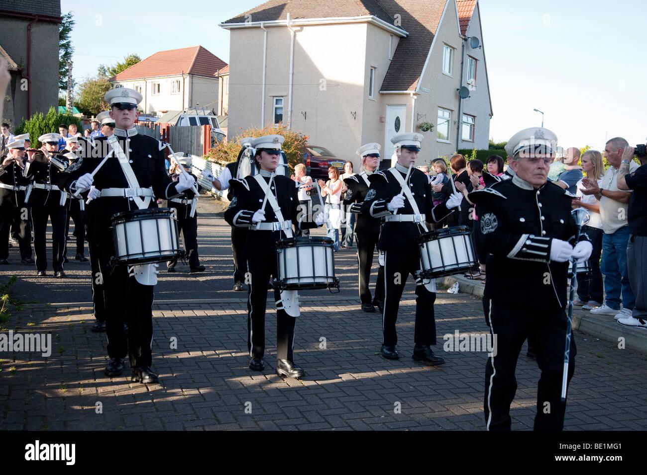 Cambuslang Volunteers Flute Band, a Loyalist/Orange Marching Band on parade in Kilwinning, Ayrshire, Scotland - Stock Image