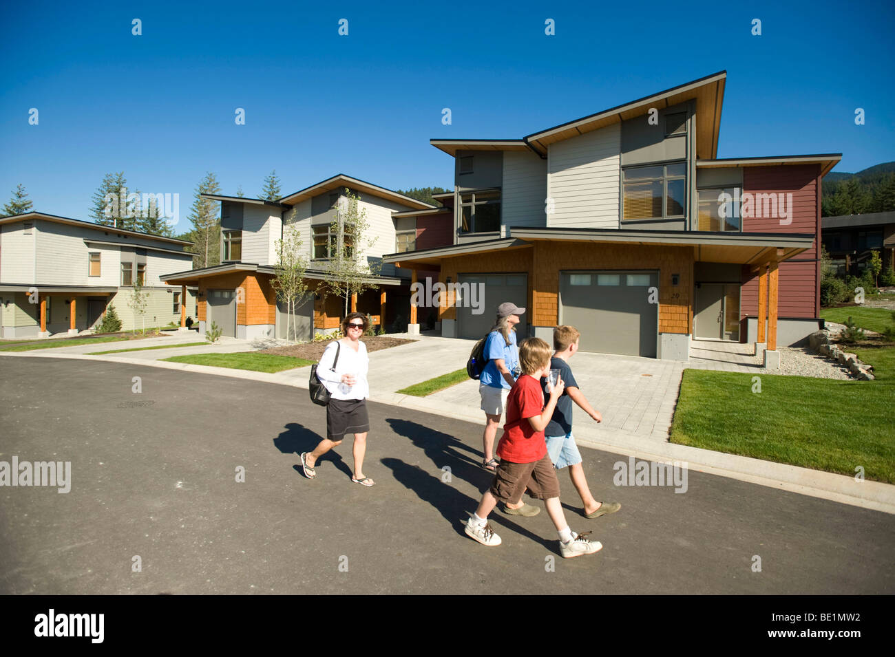 A Family walks through the 2010 Olympic Athlete's Village.  Whistler BC, Canada - Stock Image