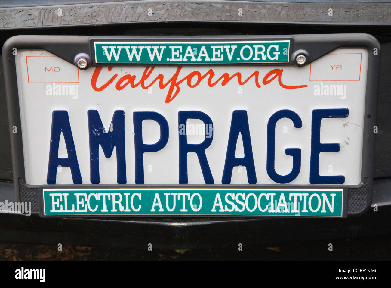 AMPRAGE\' (amperage) license plate on electric vehicle with an Stock ...