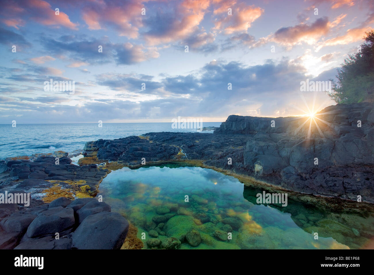 Queen's Bath with sunrise. Kauai, Hawaii. - Stock Image