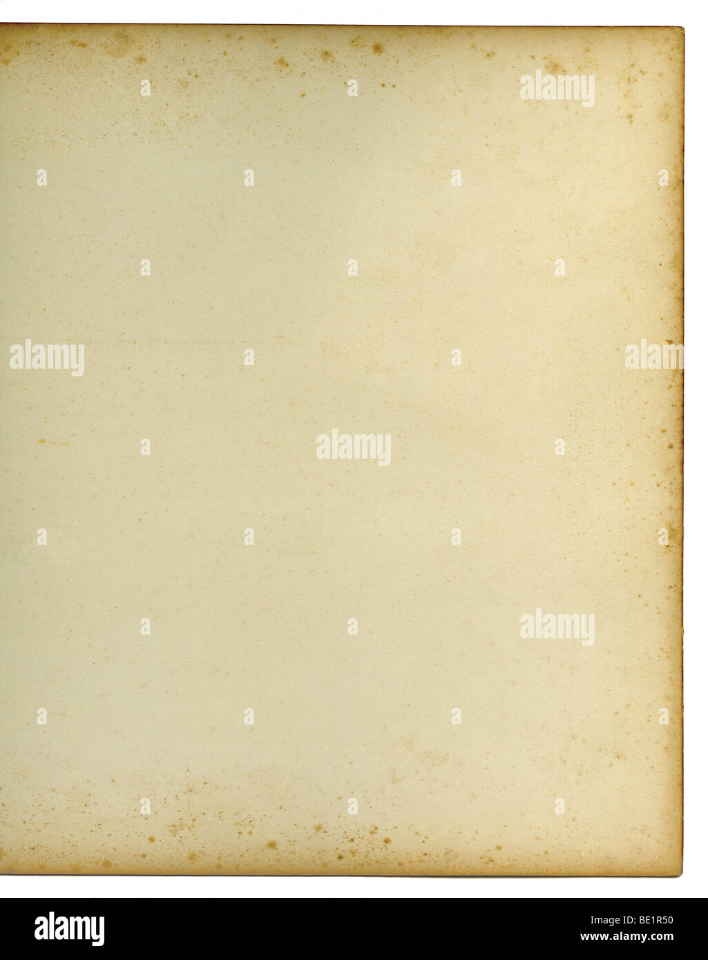 Blank page of an old writing book with age discolouration to the edges of the page and brown foxing marks - Stock Image