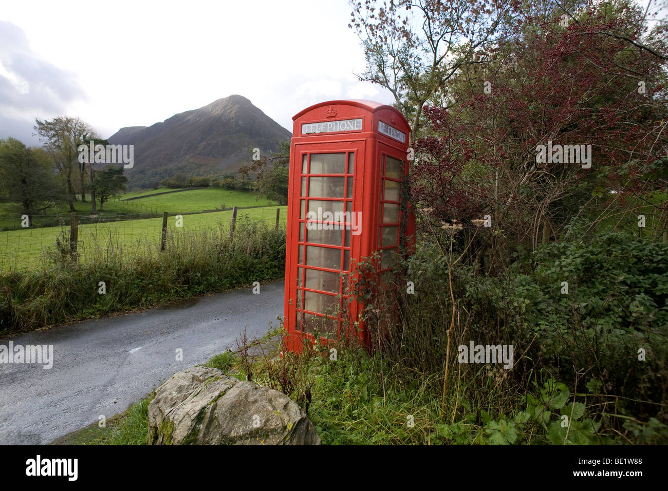 An old red telephone kiosk in the Loweswater village, Cumbria, England, UK - Stock Image