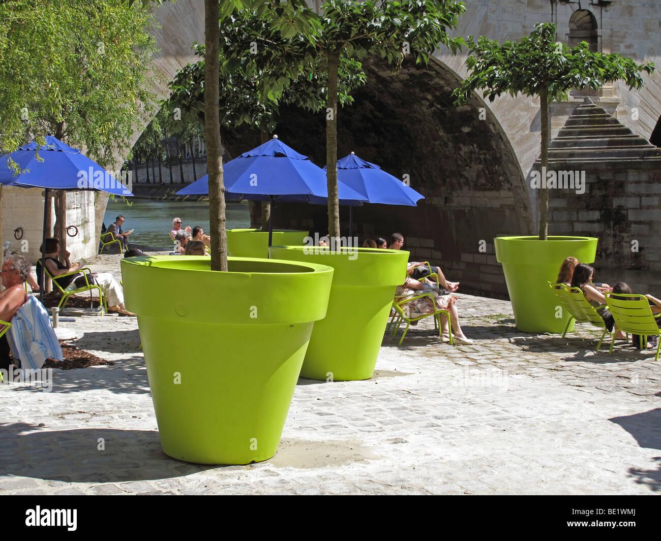 Big green flowerpot, Paris Plage,France,Paris beach,Pont Marie bridge - Stock Image