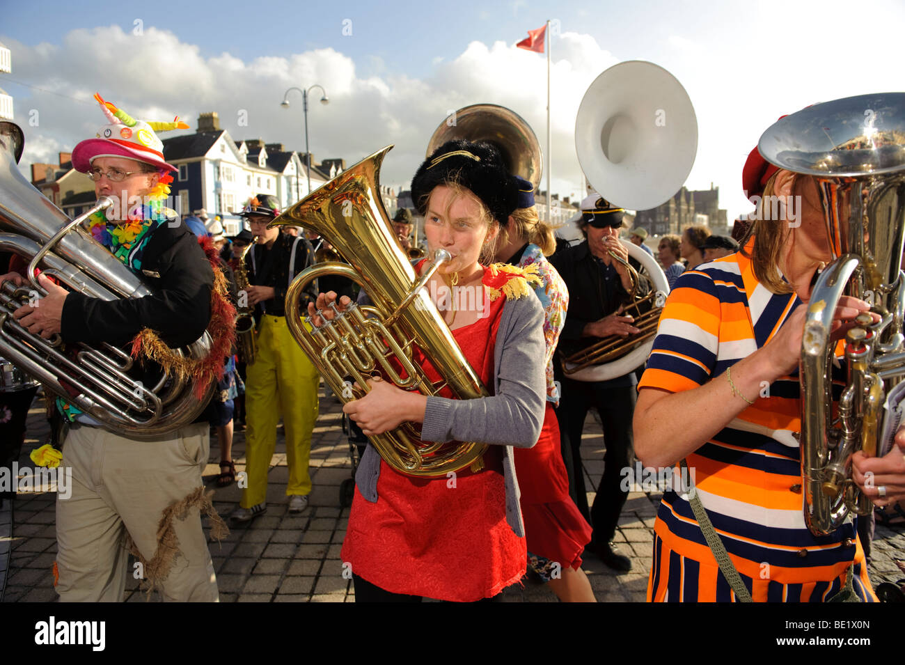 Musicians in the De Propere Fanfare belgian marching band performing on the promenade, Aberystwyth Wales UK - Stock Image