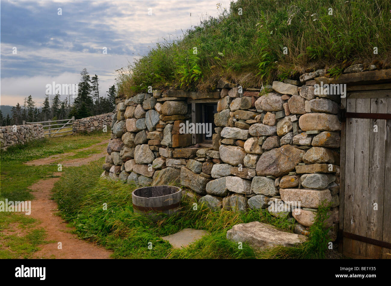 Gaelic Black House of stone with sod roof at Highland Village Museum Iona Cape Breton Island Nova Scotia Canada - Stock Image