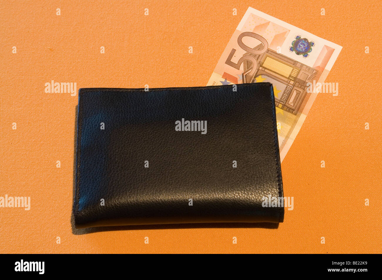 A black wallet with a euro banknote (France). Portefeuille noir avec billet de banque Euro (France). - Stock Image