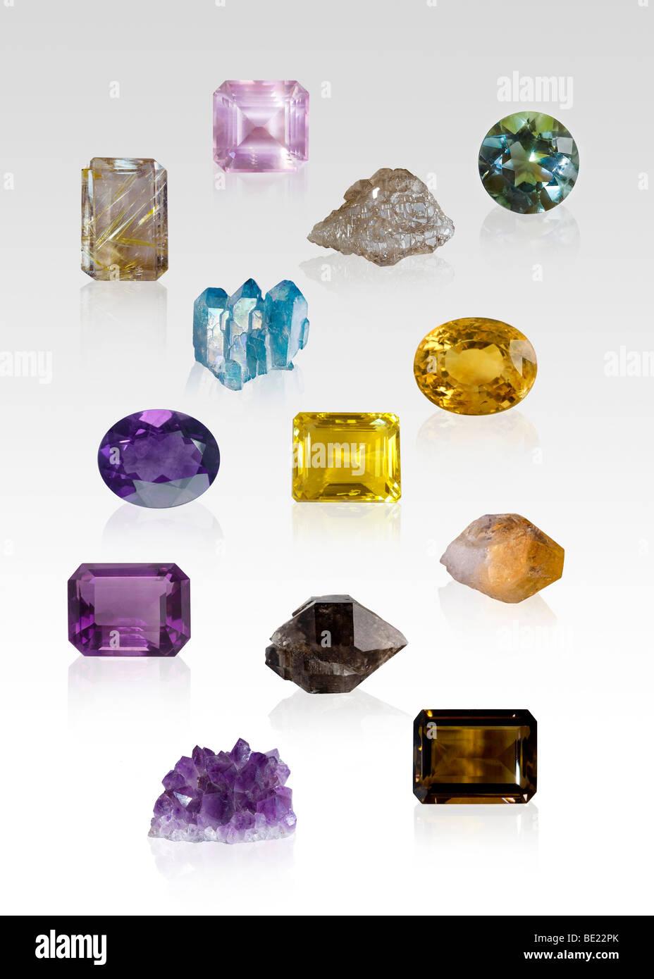Quartz gem and crystal specimens on white background - Stock Image