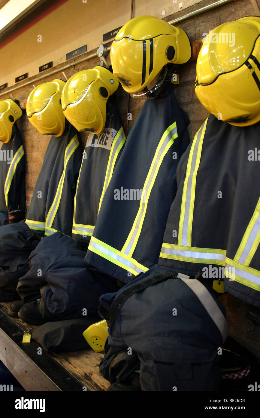 Fire Fighter's Uniforms hanging up in a Fire Station - Stock Image