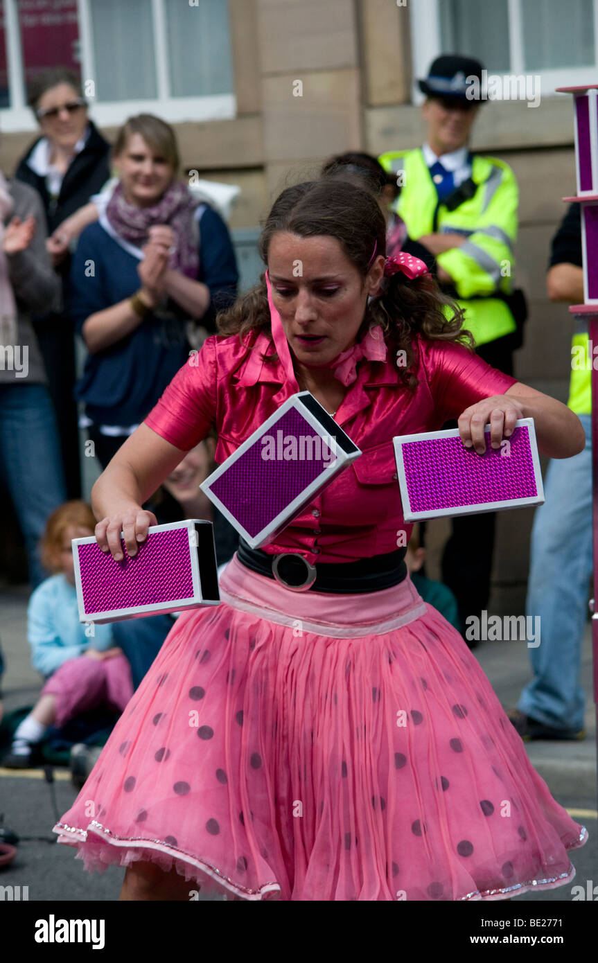 Female street performer Ashbourne International Streetfest 2009 Street theater and arts Festival in Ashbourne Derbyshire - Stock Image