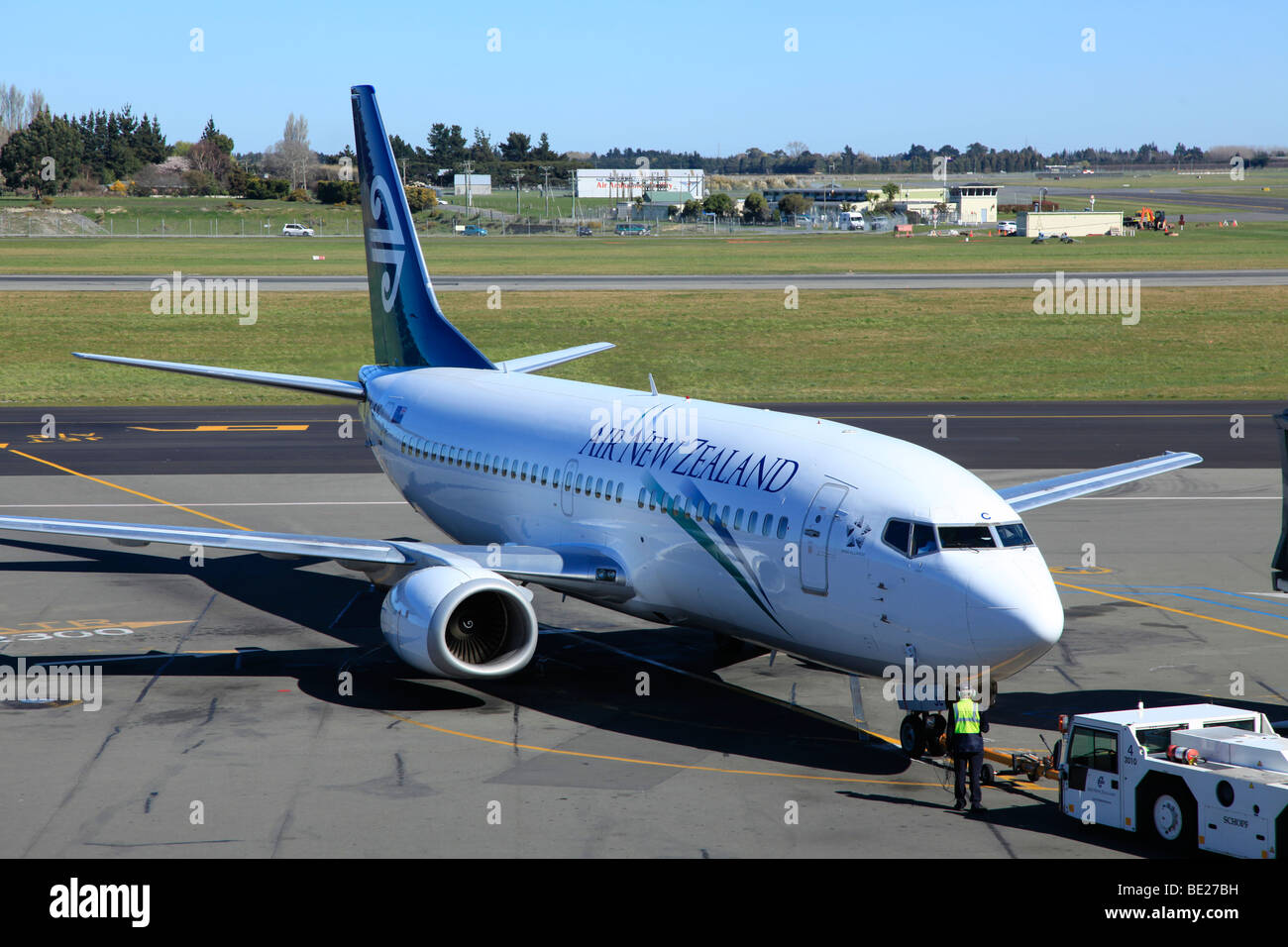 Air New Zealand Boeing 737 pushed from gate by tug at Christchurch Airport,Canterbury,South Island,New Zealand - Stock Image