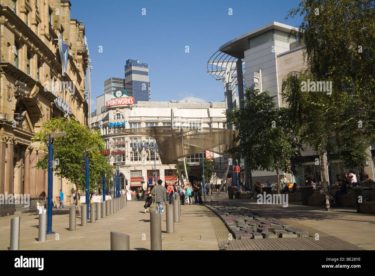 Manchester England UK Pedestrian area in front of Triangle Shopping centre in the city centre - Stock Image