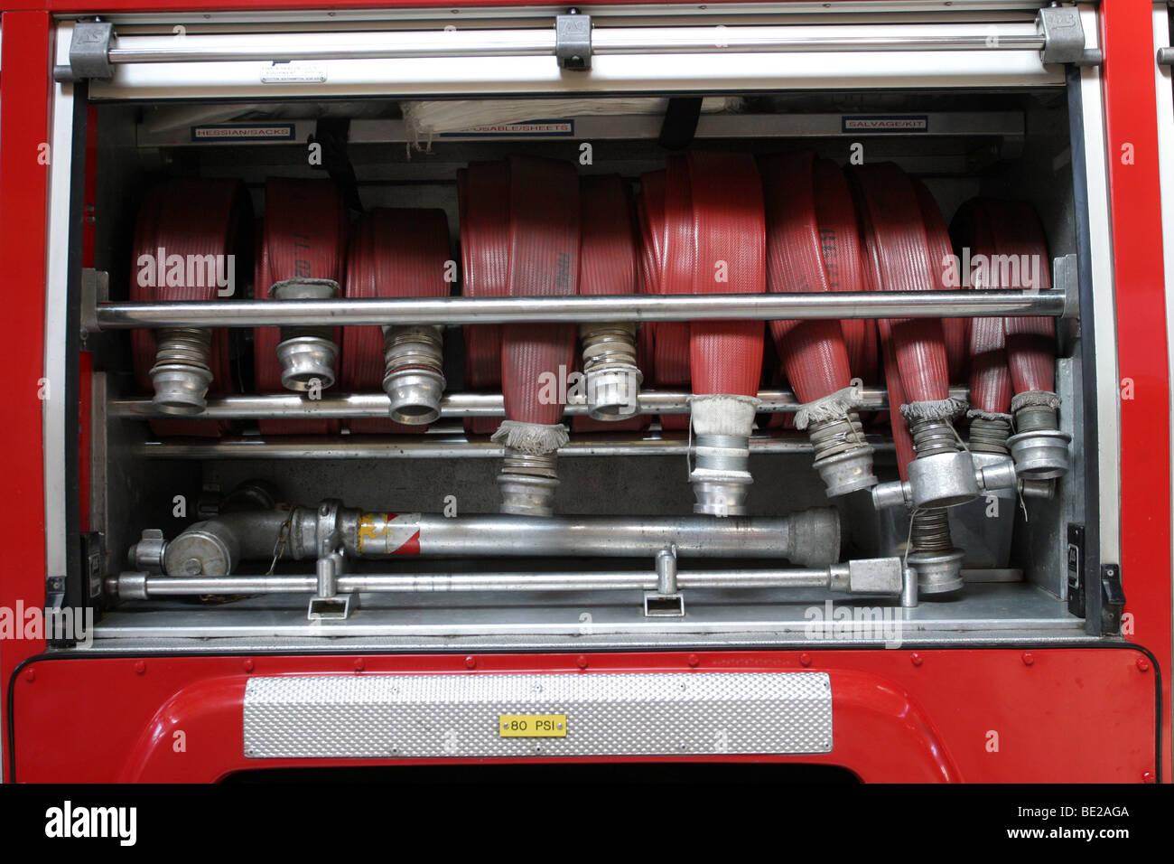 Hoses inside a fire engine - Stock Image