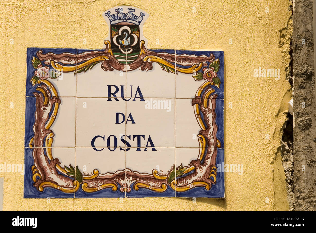 A traditional Portuguese street sign made of azulejos (tiles), bearing the street name. - Stock Image