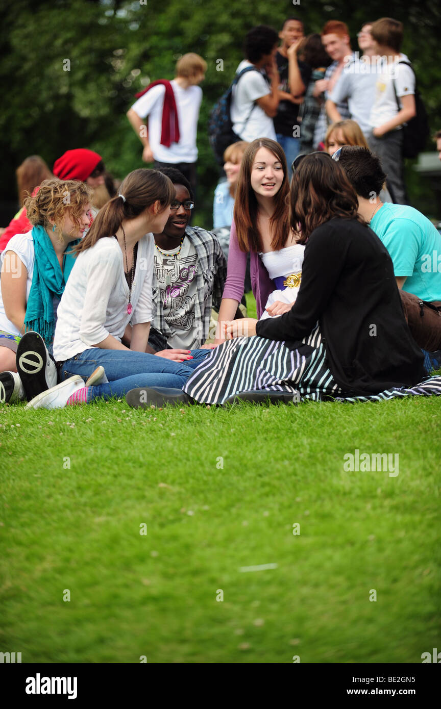Students take time out during a break at a sixth form further education college - Stock Image