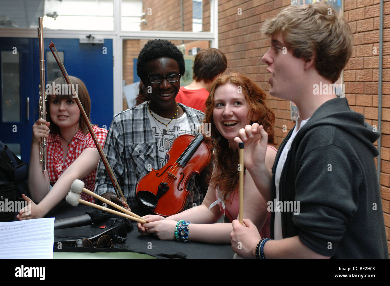 Music students practice at sixth form further education college Stock Photo