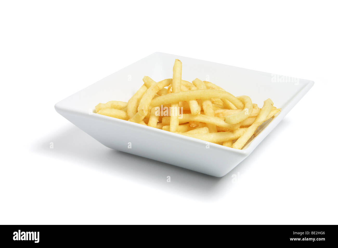 Plate of French Fries on White Background - Stock Image
