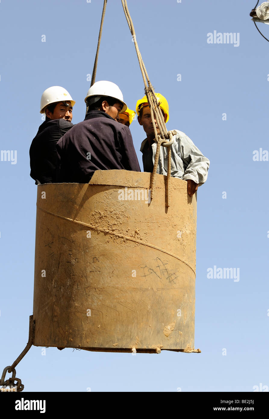 construction site of Beijing-Shanghai high speed railway in Beijing, workers in a gondola. 11-Sep-2009 - Stock Image