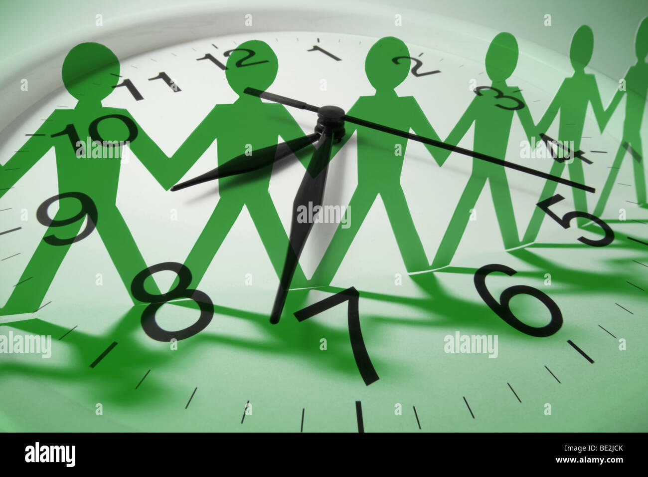 Clock and Paper Cutout Dolls - Stock Image