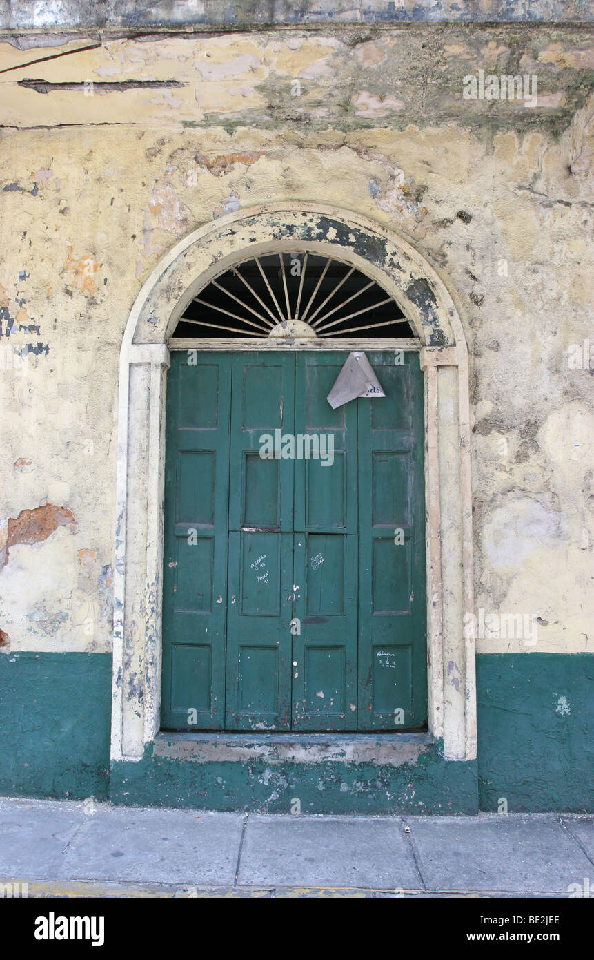 Old green door at an abandoned building of Panama City's Casco Antiguo Stock Photo